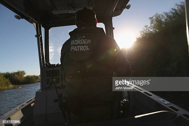S Border Patrol agents patrol the Colorado River which forms 24 miles of the USMexico border on November 17 2016 in Andrade California Border Patrol...