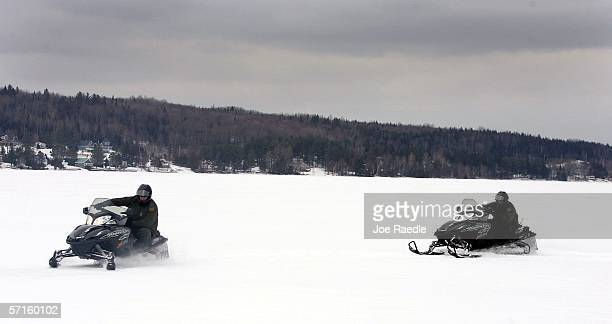 S Border Patrol Agents Paul Mulcahy and Andrew Mayer ride snowmobiles as they look for signs of illegal aliens as they cross a frozen lake that is...