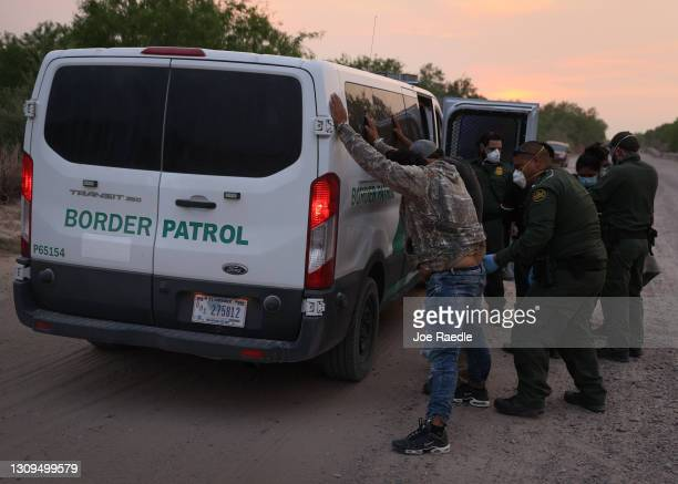 Border Patrol agents process a group of people they caught crossing the border from Mexico on March 27, 2021 in Penitas, Texas. The group made up of...