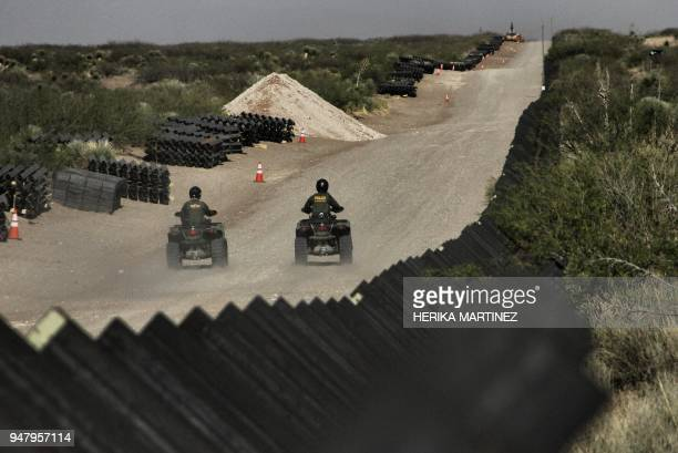 Border Patrol agents ride their ATV's along of the construction of the 32km of border wall by order of US President Donald Trump on the border...