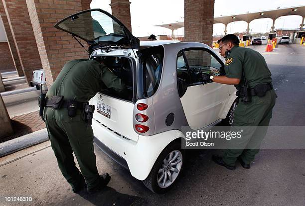 Border Patrol agents search a vehicle that was stopped while heading into Mexico at the Hidalgo border crossing on May 28 2010 in Hidalgo Texas The...
