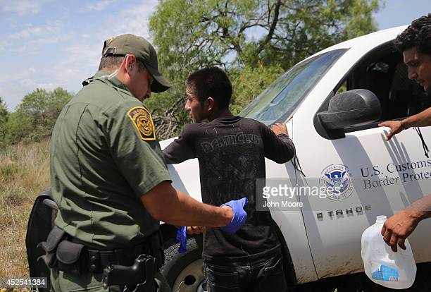 S Border Patrol agents search an undocumented immigrant after taking him into custody on July 22 2014 near Falfurrias Texas Thousands of immigrants...