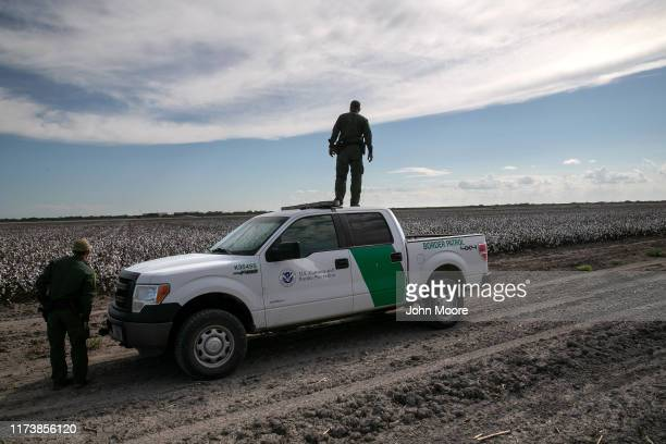 Border Patrol agents search for undocumented immigrants in a cotton field near the U.S.-Mexico border on September 10, 2019 in Penitas, Texas. Border...