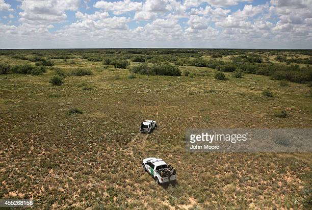 S Border Patrol agents search for undocumented immigrants in the brush on September 11 2014 near Falfurrias Texas Agents from US Customs and Border...