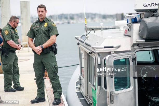 Border Patrol agents stand next to a Secure Around Safety Floatation Boat during the unveiling of a new U.S. Border Patrol Marine Unit on June 22,...