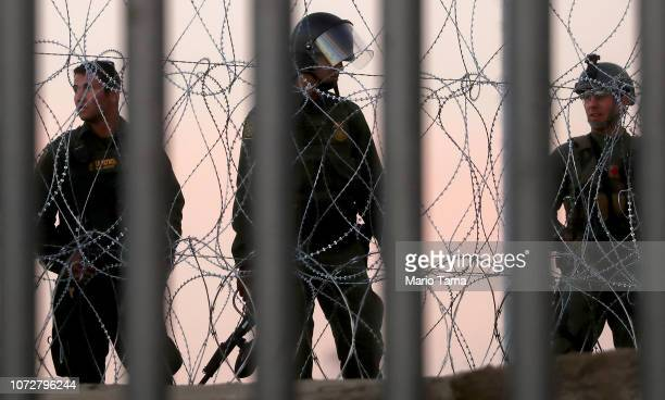 S Border Patrol agents stand watch on the US side of the USMexico border fence on November 26 2018 in Tijuana Mexico Customs and Border Protection...