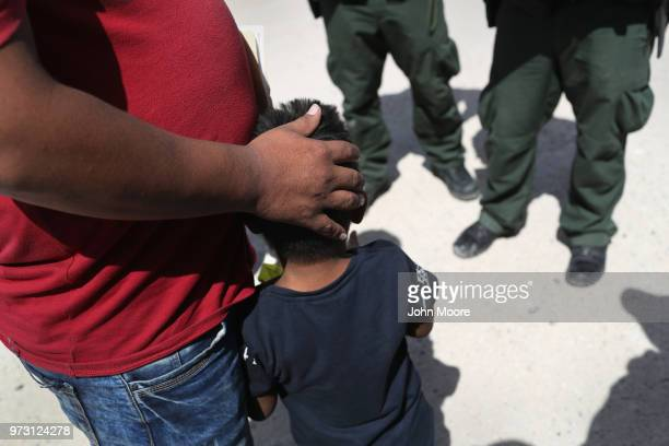 S Border Patrol agents take a father and son from Honduras into custody near the USMexico border on June 12 2018 near Mission Texas The asylum...