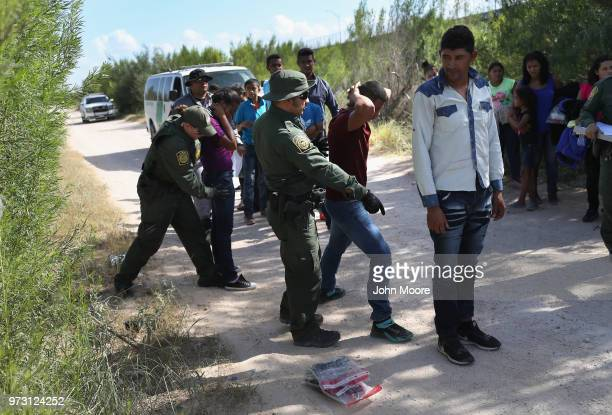 S Border Patrol agents take a group of Central American asylum seekers into custody on June 12 2018 near McAllen Texas The immigrant families were...