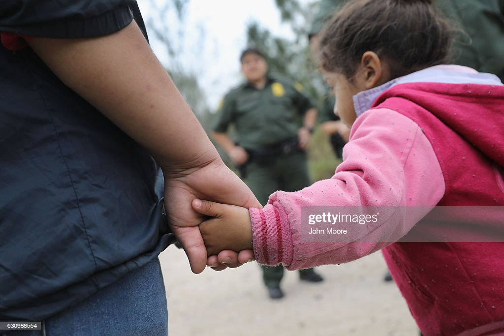 U.S. Border Patrol agents take Central American immigrants into custody on January 4, 2017 near McAllen, Texas. Thousands of families and unaccompanied children, most from Central America, are crossing the border illegally to request asylum in the U.S. from violence and poverty in their home countries. The number of immigrants coming across has surged in advance of President-elect Donald Trump's inauguration January 20. He has pledged to build a wall along the U.S.-Mexico border.