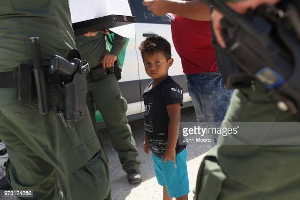 S Border Patrol agents take into custody a father and son from Honduras near the USMexico border on June 12 2018 near Mission Texas The asylum...
