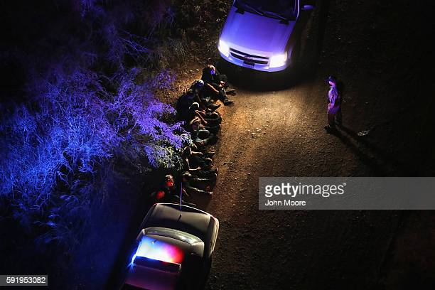 S Border Patrol agents take undocumented immigrants into custody after capturing them after they crossed Rio Grande from Mexico into Texas on August...