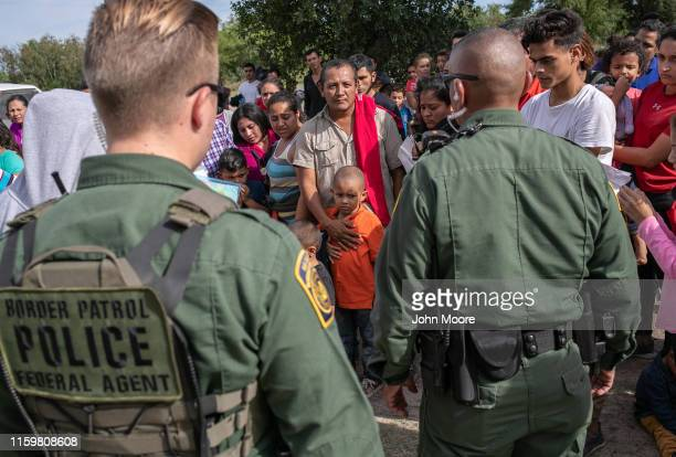 S Border Patrol agents watch over immigrants after taking them into custody on July 02 2019 in Los Ebanos Texas Hundreds of immigrants most from...