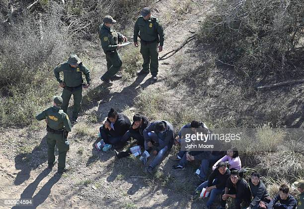 S Border Patrol agents watch over immigrants who crossed the USMexico border on January 3 2017 near McAllen Texas Thousands of families and...