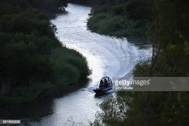 S Border Patrol boat speeds down the Rio Grande at the USMexico border on August 17 2016 in Roma Texas Thousands of illegal immigrants continue to...
