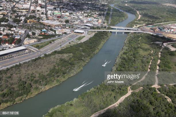 S Border Patrol boats move along the Rio Grande near an international crossing between the United States and Mexico on March 16 2017 in Hidalgo Texas...