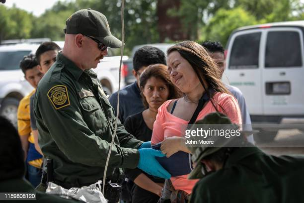 Border Patrol checks the arm of an immigrant from Guatemala after taking her into custody on July 02, 2019 in Los Ebanos, Texas. The woman said she...