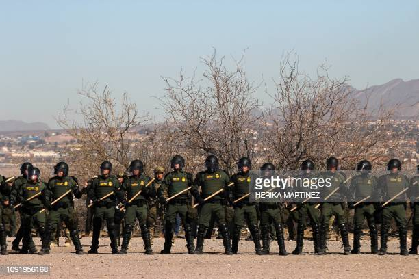 Border Patrol, Immigration and Customs Enforcement and Customs and Border Protection agents take part in a safety drill in the Anapra area in Sunland...