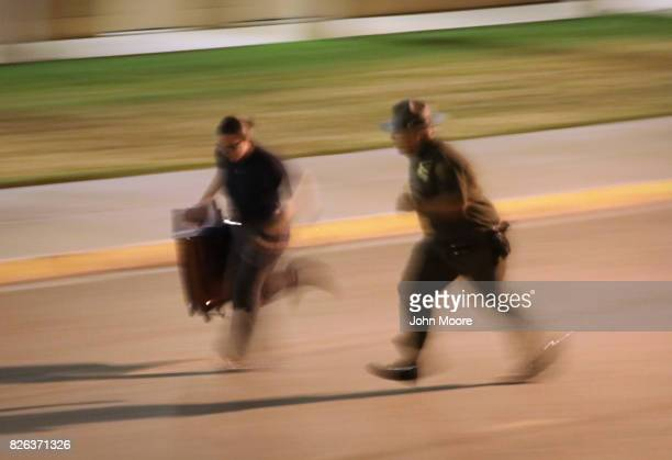 S Border Patrol instructor yells and chases a trainee upon her initial arrival to the US Border Patrol Academy on August 2 2017 in Artesia New Mexico...