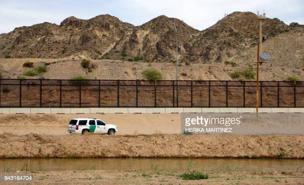 Border Patrol is seen from Mexico while patrolling along the border line between the cities of El Paso Texas in the United States and Ciudad Juarez...