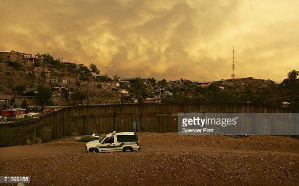 S border Patrol keeps watch along the US Mexican border June 21 2006 in Nogales Arizona US President George W Bush plans to deploy a total 6000...
