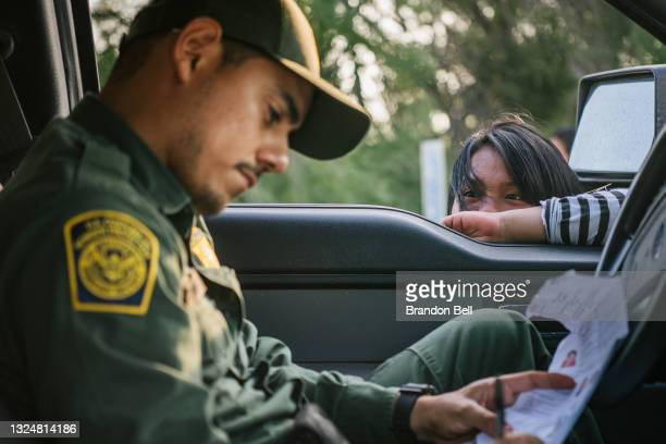 Border patrol officer begins processing a young girl after she crossed the Rio Grande into the U.S. On June 21, 2021 in La Joya, Texas. A surge of...