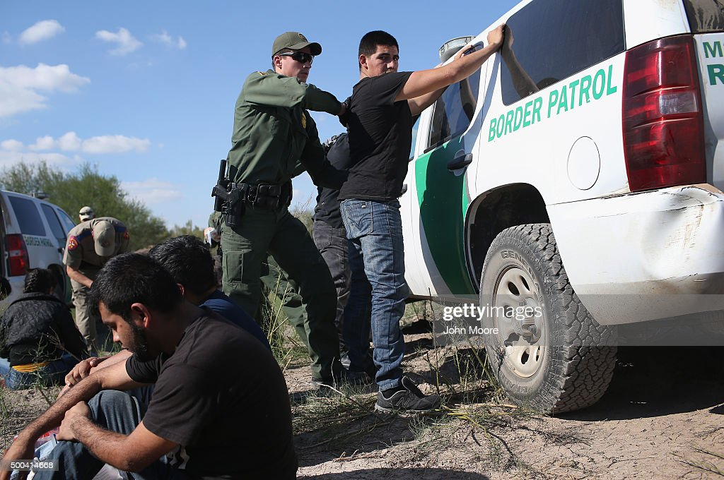 S. Border Patrol officer body searches an undocumented immigrant after he illegally crossed the U.S.-Mexico border and was caught on December 7, 2015 near Rio Grande City, Texas. Border Patrol agents continue to detain hundreds of thousands of undocumented immigrants trying to avoid capture after crossing into the United States, even as migrant families and unaccompanied minors from Central America cross and turn themselves in to seek assylum.