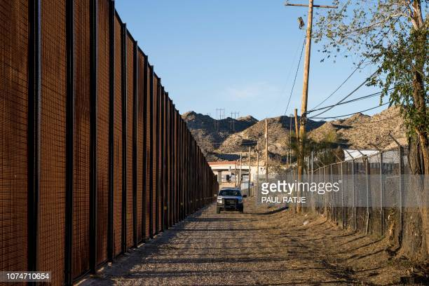 A Border Patrol officer makes his rounds near central El Paso on December 23 2018 The US government began a Christmastime shutdown early on December...