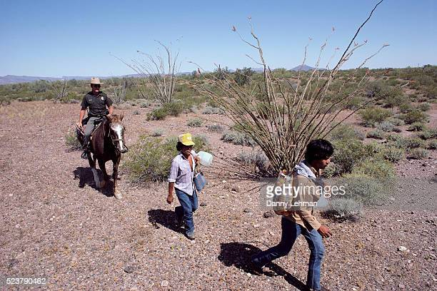 Border Patrol Officer with Two Mexican Emigrants