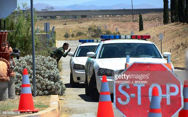 Border Patrol officers guard the US Border Patrol facility in Murrieta California on July 3 where tension is rising over the arrival of undocumented...