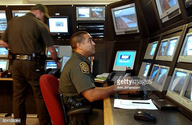 US Border Patrol officers monitor screens looking for people trying to enter the US from Mexico illegally at the El Centro Station in El Centro