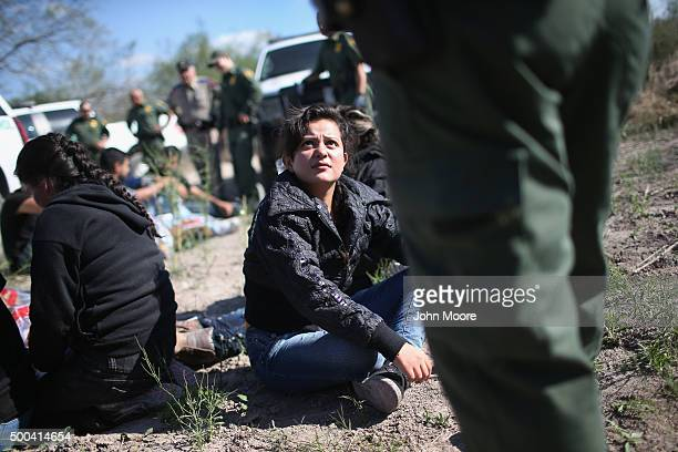 S Border Patrol questions an undocumented immigrant from El Salvador after she illegally crossed the USMexico border and was caught with a group of...