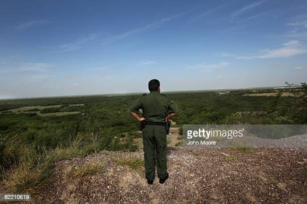 S Border Patrol supervisor Eugenio Rodriguez looks over the landscape near the Rio Grande River and surrounding environs August 7 2008 in Laredo...