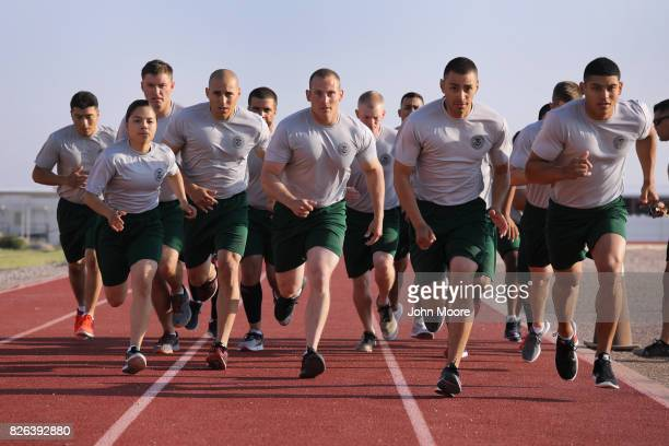 S Border Patrol trainees run during a physical training class at the US Border Patrol Academy on August 3 2017 in Artesia New Mexico All new agents...