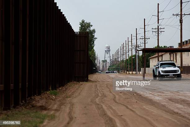 A US Border Patrol truck sits parked next to the border fence in Calexico California US on Monday Oct 12 2015 Among Rabobank's 119 branches in...