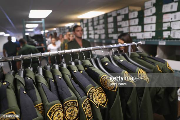 S Border Patrol uniforms hang as new arrivals are fitted at the US Border Patrol Academy on August 3 2017 in Artesia New Mexico All new agents must...