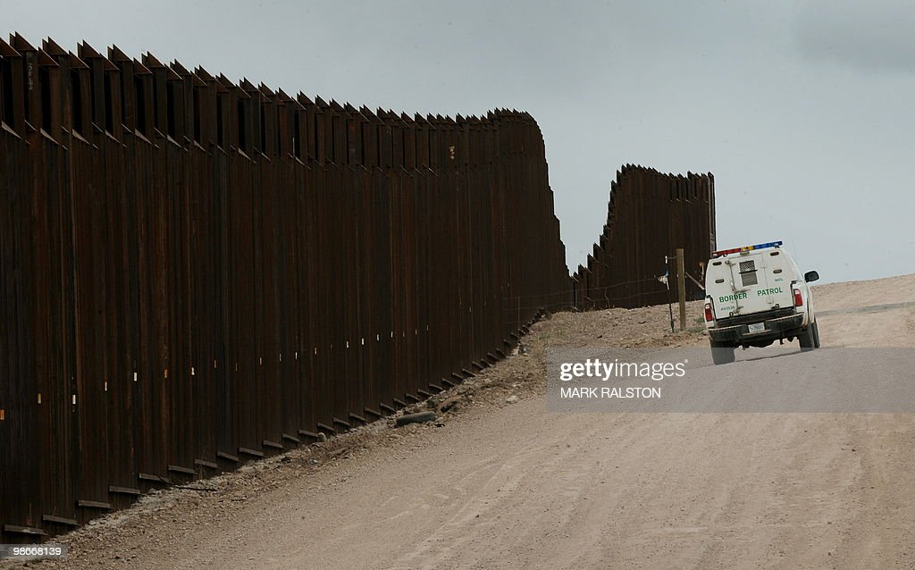 A US Border Patrol vehicle drives along : News Photo
