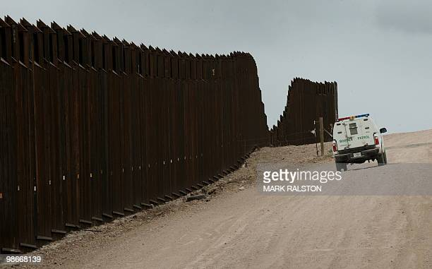 Border Patrol vehicle drives along the fence seperating the US from Mexico near the town of Nogales Arizona on April 23 2010 Two Republican senators...
