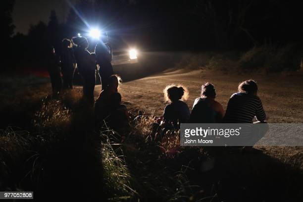 S Border Patrol vehicle illuminates a group of Central American asylum seekers before taking them into custody near the USMexico border on June 12...