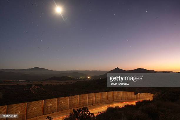 Border Patrol vehicle is driven along the USMexico border fence as agents carry out special operations following the first fatal shooting of a US...