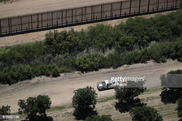 S Border Patrol vehicle is seen along the US/Mexico border fence on June 19 2018 in Tornillo Texas The Trump administration created a policy of zero...