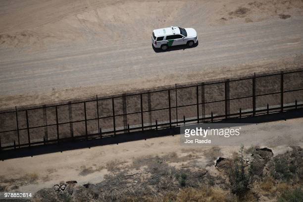 S Border Patrol vehicle is seen along the US/Mexico border fence on June 19 2018 in Tornillo Texas The Trump administration is enforcing a policy of...