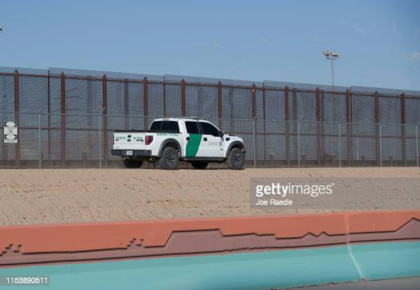 Border Patrol vehicle is seen as it drives along the border fence separating the United States from Mexico on June 05, 2019 in El Paso, Texas. In...