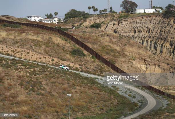 S Border Patrol vehicle patrols near the USMexico border on May 11 2017 in San Diego California The border spans almost 2000 miles from the Gulf of...