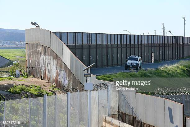 Border Patrol vehicle sits along the USMexico border wall on January 25 2017 in San Ysidro California US President Donald Trump issued an executive...