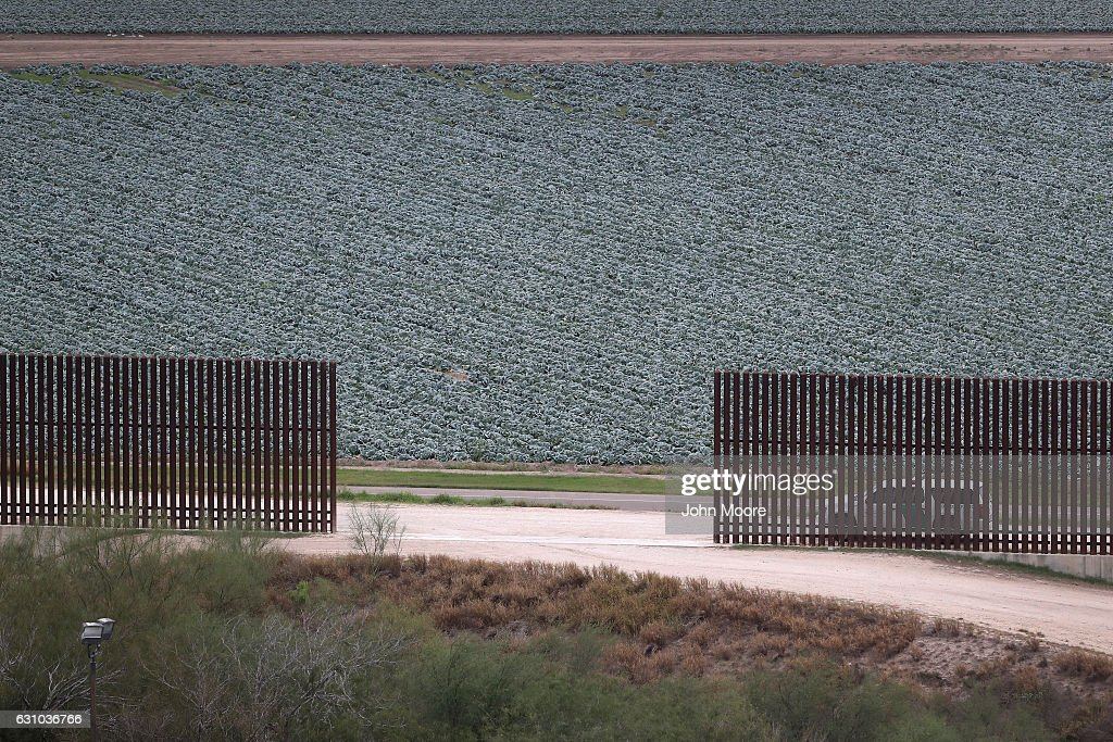 A U.S. Border Patrol vehicle sits waiting for illegal immigrants at a fence opening near the U.S.-Mexico border on January 5, 2017 near McAllen, Texas. The number of incoming immigrants has surged ahead of the upcoming Presidential inauguration of Donald Trump, who has pledged to build a wall along the U.S.-Mexico border.