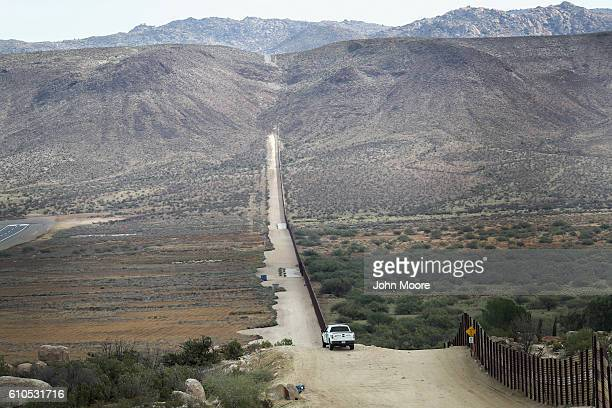 S Border Patrol vehicle stands guard along the USMexico border fence on September 26 2016 in Jacamba Hot Springs California