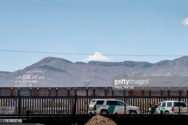 US Border Patrol vehicles are pictured near the Paso Del Norte International Bridge at the USMexico border in El Paso Texas on September 12 2019 The...