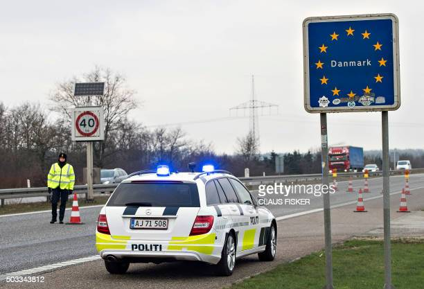 Border police are seen on January 4 2016 at the DanishGerman boarder town Krusaa Denmark announced the immediate introduction of random controls at...