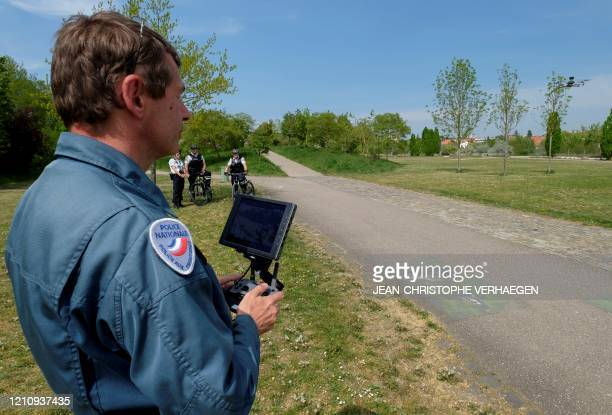 Border police officer makes a demonstration of a surveillance drone used to ensure the enforcement of the confinement, on April 24, 2020 in Metz,...