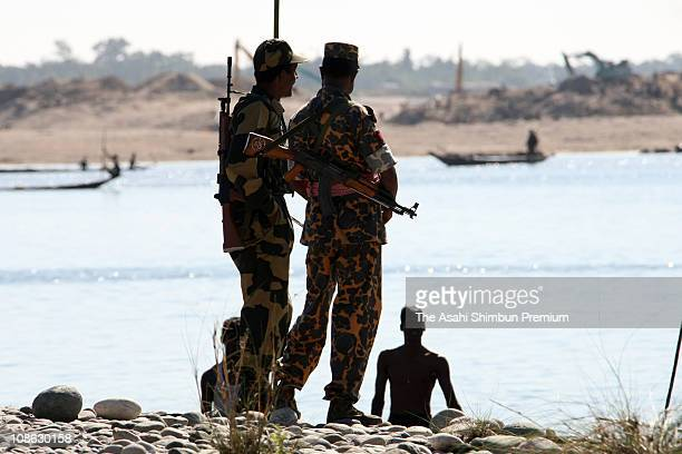 Border police officers of both India and Bangladesh are seen at a quarry on October 30 2007 in Bangladesh Stones are valuavle for Bangladesh as most...